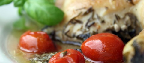 Roasted chicken with basil and cherry tomatos